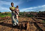 Modolasi Mkhondya stands where her new house will soon rise in Karonga, a town in northern Malawi where the ACT Alliance has worked with local residents to recover from a 2009 earthquake.