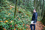Castagna Chef, Matthew Lightner, foraging for wild greens from a forest in Portland, Oregon