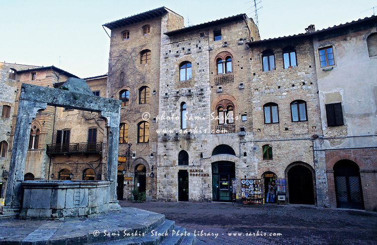 Empty square at dusk in the medieval village of San Gimignano, Italy.