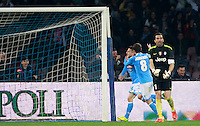 Calcio, Serie A: Napoli vs Juventus. Napoli, stadio San Paolo, 30 marzo 2014. <br /> Napoli forward Dries Mertens, of Belgium, left, celebrates with teammate Jorginho, of Brazil, after scoring, as Juventus goalkeeper Gianluigi Buffon, right, reacts during the Italian Serie A football match between Napoli and Juventus at Naples' San Paolo stadium, 30 March 2014. Napoli won 2-0.<br /> UPDATE IMAGES PRESS/Isabella Bonotto