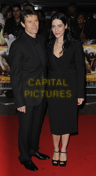 Willem Dafoe & Giada Colagrande .UK Premiere of 'John Carter' at BFI Southbank, London, England..March 1st 2012.full length suit blazer dress married husband wife black .CAP/CAN.©Can Nguyen/Capital Pictures.