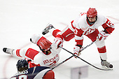 Kasey Boucher (BU - 3), Kaleigh Fratkin (BU - 13) - The Boston University Terriers defeated the visiting University of Connecticut Huskies 4-2 on Saturday, November 19, 2011, at Walter Brown Arena in Boston, Massachusetts.