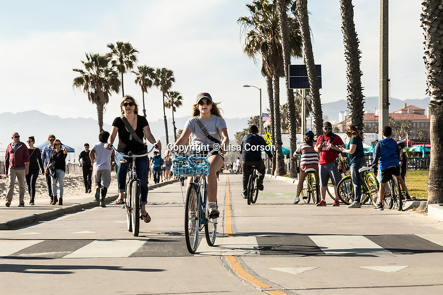 Cyclists ride between Santa Monica and Venice on the oceanside bike path. Santa Monica, California. Los Angeles area.