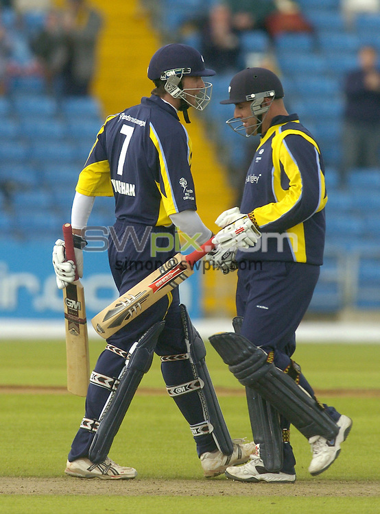Picture by Chris Whiteoak/SWPIX.COM, C and G Trophy, Yorkshire v Scotland, 29/05/06..Copyright>>Simon Wilkinson>>07811267706..Yorkshire's Michael Vaughan is congratulated on his 50 by Australian team mate Darren Lehmann