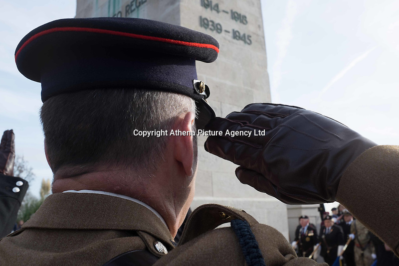Pictured: An ex serviceman salutes during the service Friday 11 November 2016<br /> Re: Remembrance Day service at the Cenotaph in Swansea, south Wales, UK.