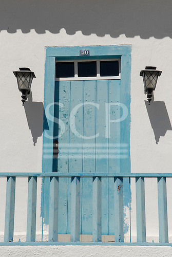 Goias Velho, Brazil. Well preserved colonial town; colonial architecture; entrance door with lamps, bubbling paint.