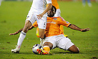 Houston Dynamo's  (4) Jermaine Taylor knocks the ball away from Los Angeles Galaxy's (5)  Sean Franklin in the second half. The Galaxy won 1-0 in the MLS Cup at the Home Depot Center. Los Angeles Galaxy 1-0 over the Dynamo USA, Sunday, Nov. 20. 20011, in Carson, California. Photo by Matt A. Brown/isiphotos.com