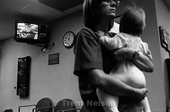 Laura Nelson, Noah Nelson in the waiting room of the San Ramon Medical Center, while a violent movie plays on the television.<br />
