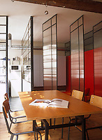 Pivoting transluscent panels, glass walls and solid partitions deliver privacy where it is needed in this loft apartment