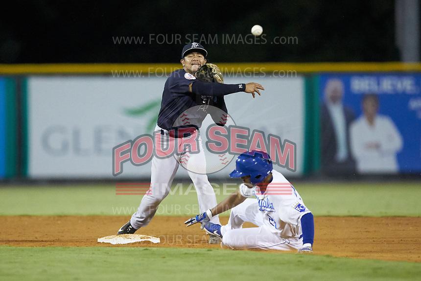 Pulaski Yankees second baseman Luis Santos (13) makes a throw to first base as Rafael Romero (21) of the Burlington Royals slides into second base at Burlington Athletic Stadium on August 25, 2019 in Burlington, North Carolina. The Yankees defeated the Royals 3-0. (Brian Westerholt/Four Seam Images)