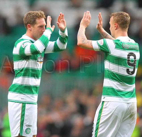 25.10.2015. Glasgow, Scotland. Scottish Premier League. Celtic versus Dundee United. Kris Commons celebrates with Leigh Griffiths