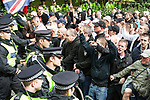 © Joel Goodman - 07973 332324 - all rights reserved . 11/09/2010 . London , UK . The English Defence League ( EDL ) hold a counter demonstration as Muslims Against Crusades hold a demonstration outside the American Embassy in London on the 9th anniversary of the terrorist attack on the World Trade Centre and other targets in America . Photo credit : Joel Goodman