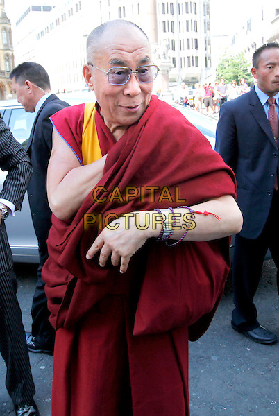 His Holiness the Dalai Lama arrives at Westminster Abbey, London, where he was attending a service, England..June 20th, 2012.half length red yellow maroon burgundy robe glasses arm bracelets.CAP/CAM.©Andre Camara/Capital Pictures.