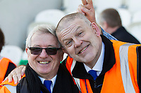 Two friendly stewards have their moment photo bombed before Colchester United vs Carlisle United, Sky Bet EFL League 2 Football at the JobServe Community Stadium on 23rd February 2019