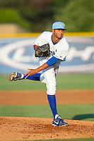 Burlington Royals relief pitcher Christian Flecha (17) follows through on his delivery against the Princeton Rays at Burlington Athletic Park on July 11, 2014 in Burlington, North Carolina.  The Rays defeated the Royals 5-3.  (Brian Westerholt/Four Seam Images)
