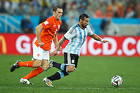 Ezequiel Lavezzi of Argentina takes on Stefan de Vrij of the Netherlands