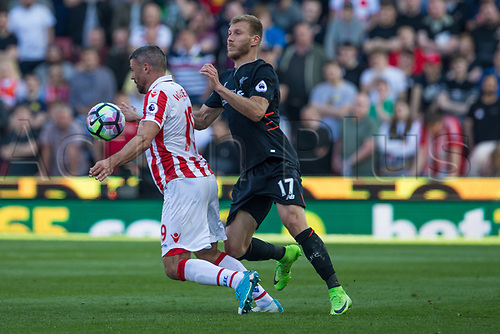 April 8th 2017, bet365 Stadium, Stoke on Trent, Staffordshire, England; EPL Premier League football, Stoke City versus Liverpool; Stoke City's Jonathan Walters and Liverpool's Ragnar Klavan fight for the loose ball