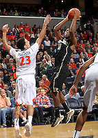 Wake Forest guard Codi Miller-McIntyre (00) shoots next to Virginia guard London Perrantes (23) during the first half of an NCAA basketball game Wednesday Jan. 08, 2014 in Charlottesville, VA. (Photo/The Daily Progress/Andrew Shurtleff)