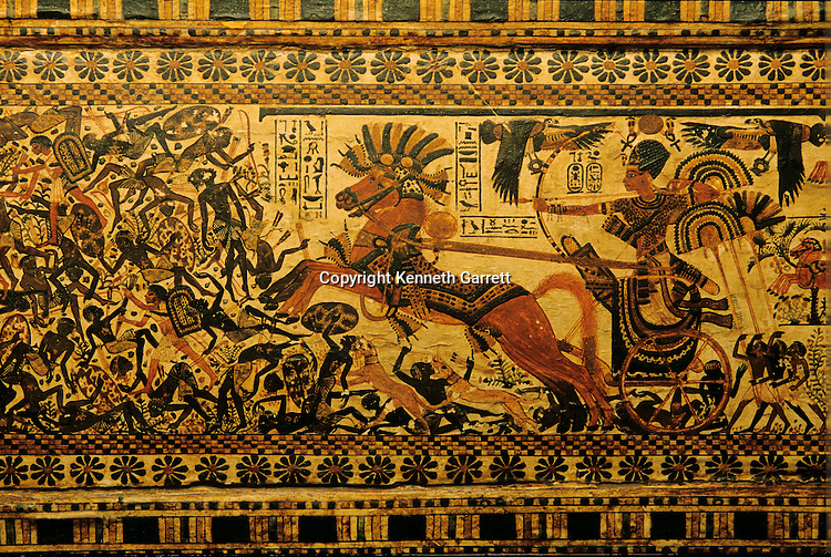 Painted box depicts Tutankhamun on chariot chasing nubians,Tutankhamun and the Golden Age of the Pharaohs, Page 175