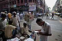 Old Indian men reading newspapers on Chitpur road in Kolkata.West Bengal, India 2009, Arindam Mukherjee