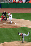 The Nationals Marlon Byrd (26) connects for a ground-rule double which knocked Braves pitcher Kyle Davies (below) out of the game in the bottom of the sixth inning on. Monday, May 30, 2005. The Washington Nationals defeated the Atlanta Braves 3-2 at RFK Stadium in Washington, DC.