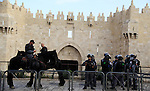 Israeli policemen secure the area where a Palestinian stabbed two police officers, then other police forces opened fire and killed him, but also wounded one of their own, at the Damascus Gate of Jerusalem's Old City, Saturday, Oct. 10, 2015. Palestinians carried out two stabbing attacks in Jerusalem on Saturday before being shot dead by police, while another two Palestinians were killed during a violent demonstration near the Gaza border fence. The violence, including the first apparent revenge attack by an Israeli Friday and increasing protests by Israel's own Arab minority, has raised fears of the unrest spiraling further out of control. Photo by Mahfouz Abu Turk