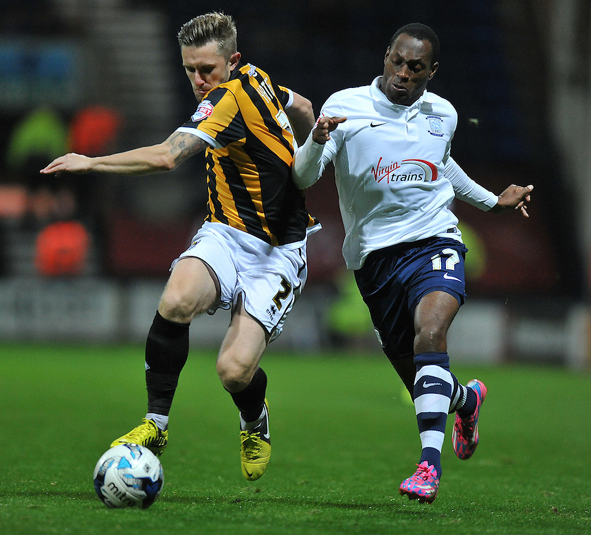 Preston North End's Kyel Reid battles with Port Vale's Adam Yates<br /> <br /> Photographer Dave Howarth/CameraSport<br /> <br /> Football - Johnstone's Paint Trophy Northern Area Second Round - Preston North End v Port Vale - Tuesday 07th October 2014 - Deepdale - Preston<br />  <br /> &copy; CameraSport - 43 Linden Ave. Countesthorpe. Leicester. England. LE8 5PG - Tel: +44 (0) 116 277 4147 - admin@camerasport.com - www.camerasport.com
