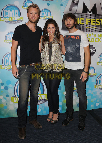 Charles Kelley, Hillary Scott, Dave Haywood of Lady Antebellum.2011 CMA Music Festival Nightly Press Conference held at LP Field. Nashville, Tennessee, USA..10th June 2011.full length jeans denim blue beige t-shirt band group cardigan.CAP/ADM/GS.©George Shepherd/AdMedia/Capital Pictures.