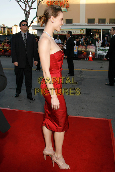 "HILARY SWANK.""The Reaping"" Los Angeles Premiere held at Mann's Village Theatre, Hollywood, California, USA..March 29th, 2007.full length red dress belt white clutch purse diamond necklace strapless profile.CAP/ADM/RE.©Russ Elliot/AdMedia/Capital Pictures"