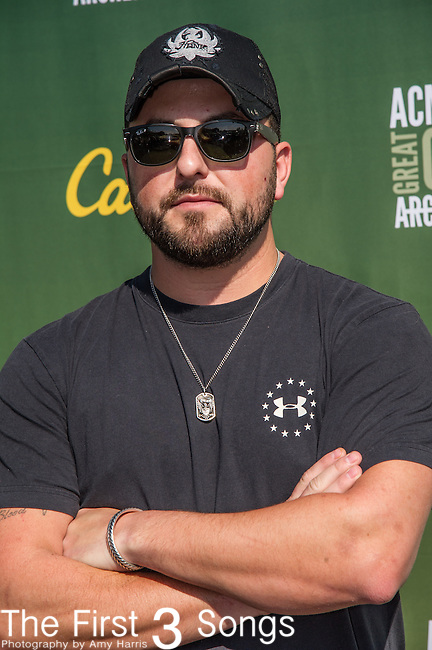 Tyler Farr attends the ACM & Cabela's Great Outdoor Archery Event during the 50th Academy Of Country Music Awards at the Texas Rangers Youth Ballpark on April 18, 2015 in Arlington, Texas.