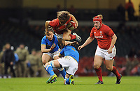 Wales Jaz Joyce leaps over Italy&rsquo;s Elisa Giordano<br /> <br /> Photographer Ian Cook/CameraSport<br /> <br /> 2018 Women's Six Nations Championships Round 4 - Wales Women v Italy Women - Sunday 11th March 2018 - Principality Stadium - Cardiff<br /> <br /> World Copyright &copy; 2018 CameraSport. All rights reserved. 43 Linden Ave. Countesthorpe. Leicester. England. LE8 5PG - Tel: +44 (0) 116 277 4147 - admin@camerasport.com - www.camerasport.com