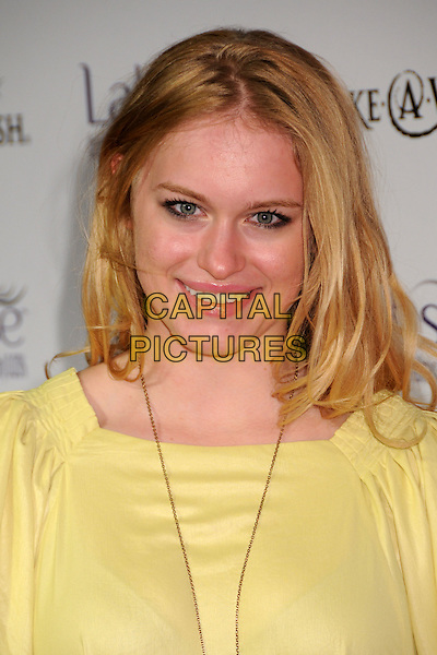 LEVEN RAMBIN.Launch Party for LATISSE held at a private gallery, Los Angeles, California, USA..March 26th, 2009.headshot portrait yellow.CAP/ADM/BP.©Byron Purvis/AdMedia/Capital Pictures.