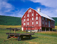Warren County, VA<br /> Weathered red barn and hay wagon on the Poor House Farm under the Shenandoah Mountains near Browntown, VA