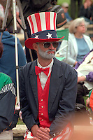 Uncle Sam age 50 observing  Memorial Day at Vietnam Wall.  St Paul  Minnesota USA