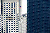 USA, New York City, Manhattan, skyscraper with US flag
