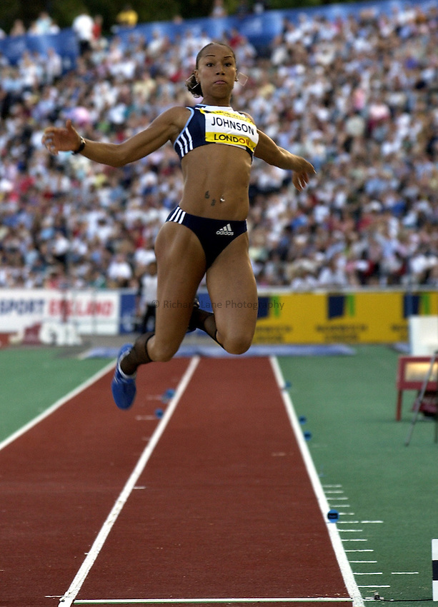Photo. Henry Browne..Norwich Union London Grand Prix Athletics at Crystal Palace. 30/07/2004..Womens Long Jump..Jade Johnson reaching to gain more distance.