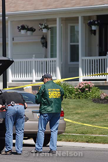 Riverton - Salt Lake County Sheriff investigators at the scene of a shooting that left one man, Shad Knighton dead Saturday June 6, 2009. His brother, Steven Knighton was arrested on suspicion of murder..