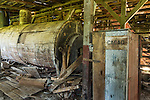 Old machinery in the abandoned coffee processing plant on the Pepperpot Plantation near Paramaribo, Suriname.