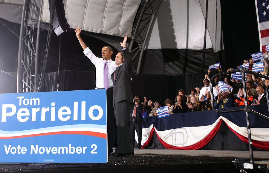 Oct 29, 2010. President Barack Obama, left, and Virginia 5th District Representative Congressman Tom Perriello, right, wave to the audience Friday during a campaign rally at the Charlottesville Pavilion in downtown Charlottesville, Va. Photo/Andrew Shurtleff