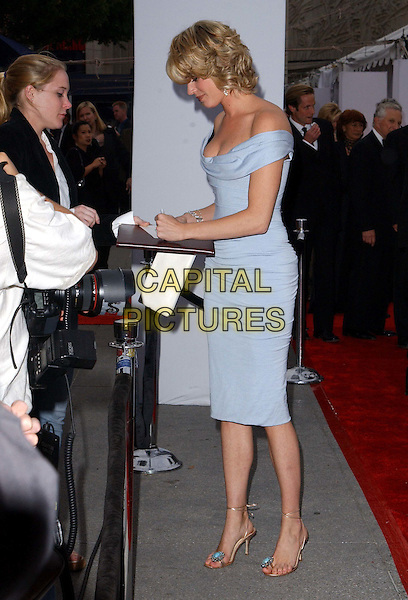 REBECCA ROMIJN-STAMOS.A The Placido Domingo & Friends Concert and Gala held at The Dorothy Chandler Pavilion in downtown L.A..light blue dress, off the shoulder, full length, full-length, signing autographs.www.capitalpictures.com.sales@capitalpictures.com.©Capital Pictures