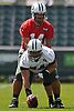 Ryan Fitzpatrick #14, New York Jets Quarterback, back, works on snaps with Center #74 Nick Mangold during the first day of team training camp at Atlantic Health Jets Training Center in Florham Park, NJ on Thursday, July 28, 2016.