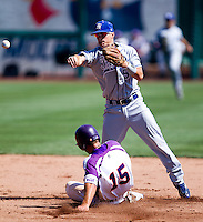 Koby Kraemer (5) of the Indiana State Sycamores turns a double play during a game against the Evansville Purple Aces in the 2012 Missouri Valley Conference Championship Tournament at Hammons Field on May 23, 2012 in Springfield, Missouri. (David Welker/Four Seam Images)