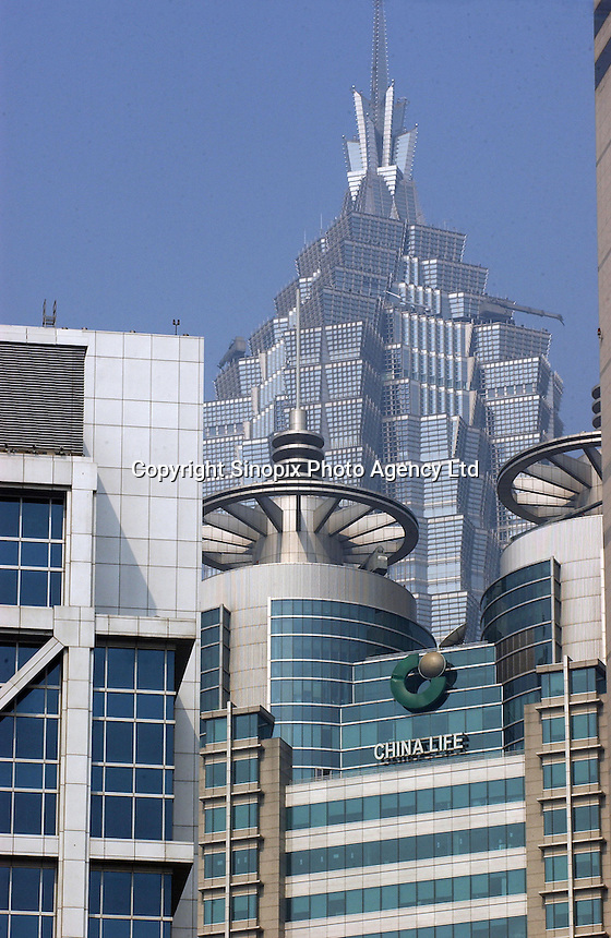 China Life Insurance Company sign on a building in front of the Jin Mao Tower in the Pudong area, Shanghai, China..