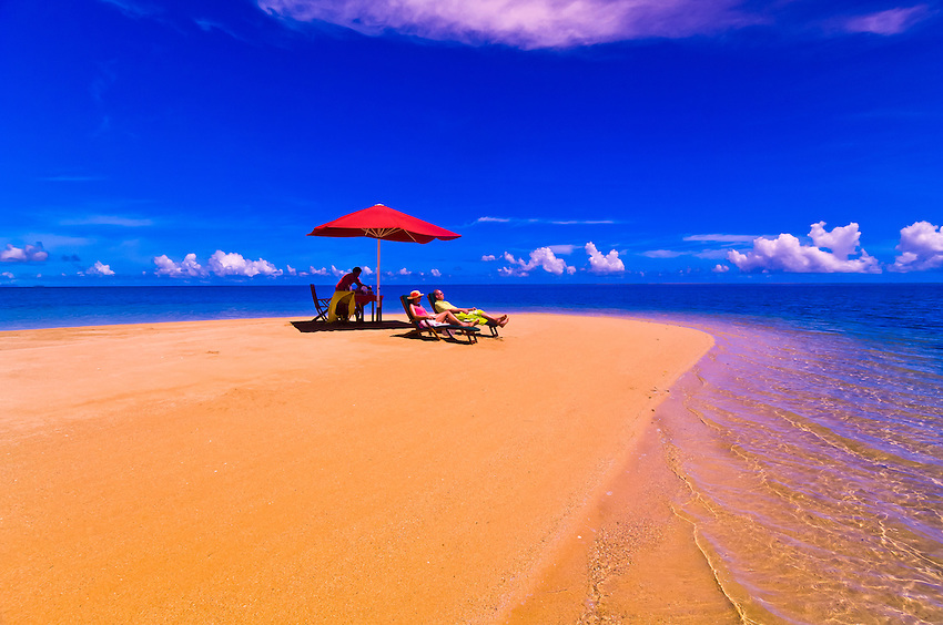 Couple enjoying a private lunch on a secluded sandbar near Nukubati Island Resort, Fiji Islands
