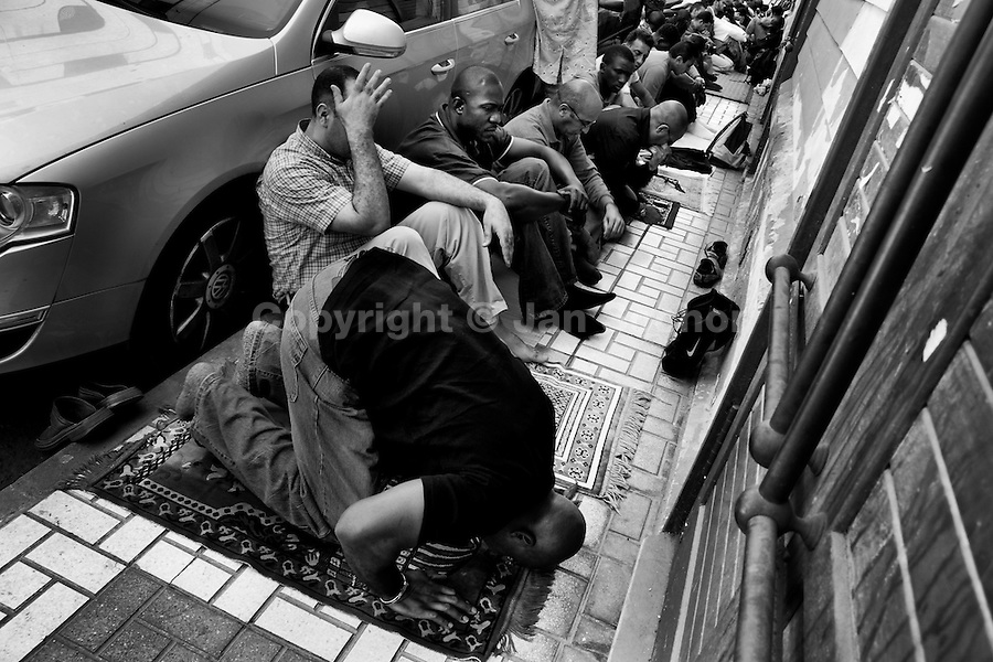 Muslims pray during the Friday worship service in front of the Assalam Mosque in the centre of Malaga, Andalusia, Spain, 28 April 2007. Strong migration flows from Africa have placed Spain among the European countries with the greatest proportion of Muslims among their inhabitants. There are about 700.000 Moroccans living legally in Spain. The province of Málaga (Andalucía) in the southern Spain belongs to areas with the highest number of people practising Islam in Europe.