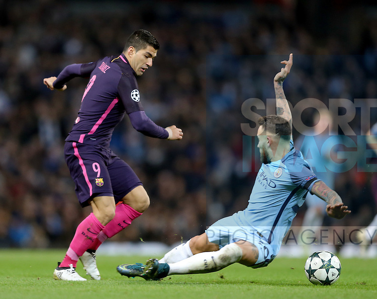 Luis Suarez of Barcelona tackled by Nicolas Otamendi of Manchester City during the Champions League Group C match at the Etihad Stadium, Manchester. Picture date: November 1st, 2016. Pic Simon Bellis/Sportimage