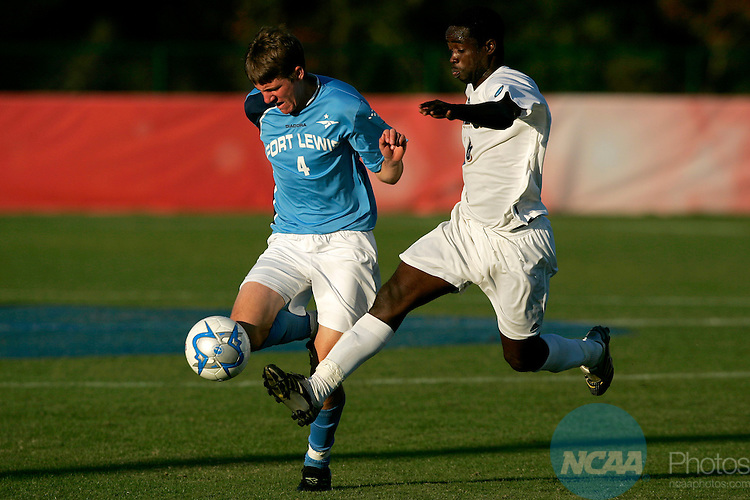 18 November 2006: Fort Lewis' Jeff Jennings (left) and Dowling College's Moussa Keita during the 2006 NCAA Division II Men's Soccer Championship held at Escambia County Stadium in Pensacola, FL.  Dowling defeated Fort Lewis 1-0 to win the National Title.  The championship was part of the Division II Sports Festival in Pensacola. Trevor Brown, Jr./NCAA Photos.