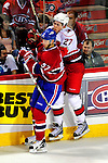 31 March 2010: Carolina Hurricanes' defenseman Brett Carson (27) checks Montreal Canadiens' left wing forward Benoit Pouliot (57) at the Bell Centre in Montreal, Quebec, Canada. The Hurricanes defeated the Canadiens 2-1. Mandatory Credit: Ed Wolfstein Photo