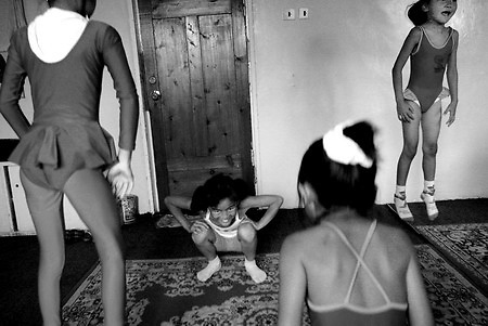 Girls jump to loosen up at the end of a contortion class in Ulan Bator.