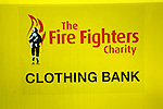 Close up yellow collection container Clothing Bank for the Fire Fighters charity